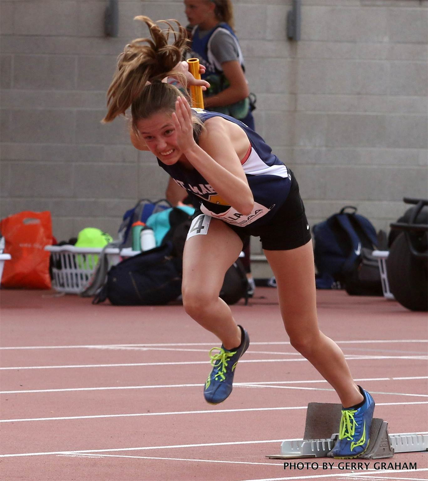 Taryn Millar carries the baton for the St. Mary's junior girls' 4x100m relay team. Photo by Gerry Graham.