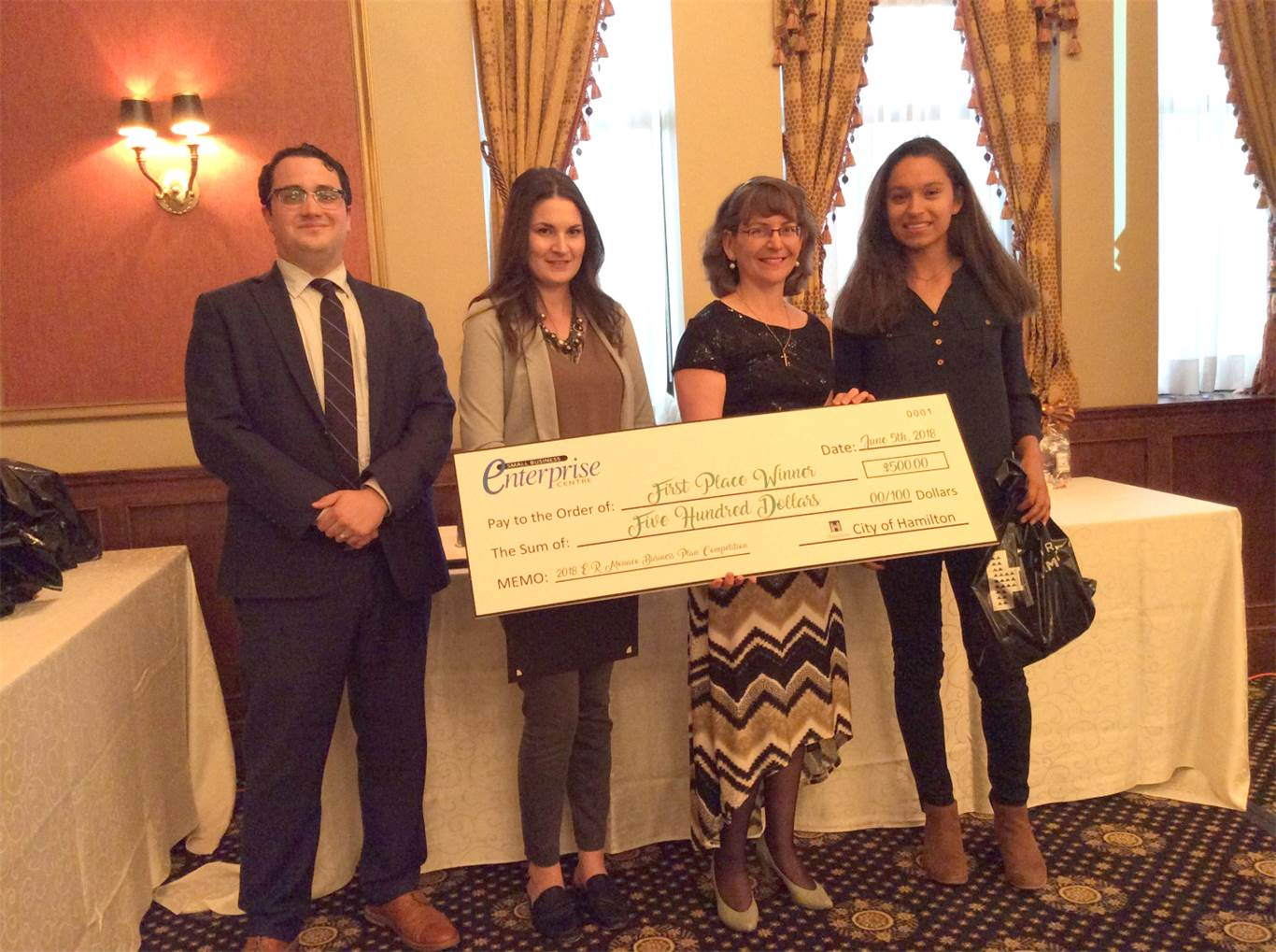 Pictured left to right:  Paul Demarco (from SimpsonWigle LAW LLP and judge for the competition), Natalie Reid (from Mohawk College and judge for the competition), Mary Monaco (Sponsor of the Program), and Jessie Drzewicki.