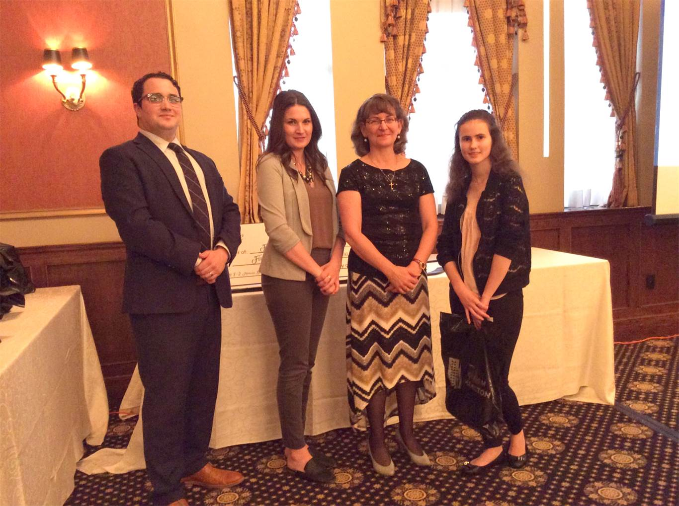Pictured left to right:  Paul Demarco (from SimpsonWigle LAW LLP and judge for the competition), Natalie Reid (from Mohawk College and judge for the competition), Mary Monaco (Sponsor of the Program), and Hailey D'Angela.