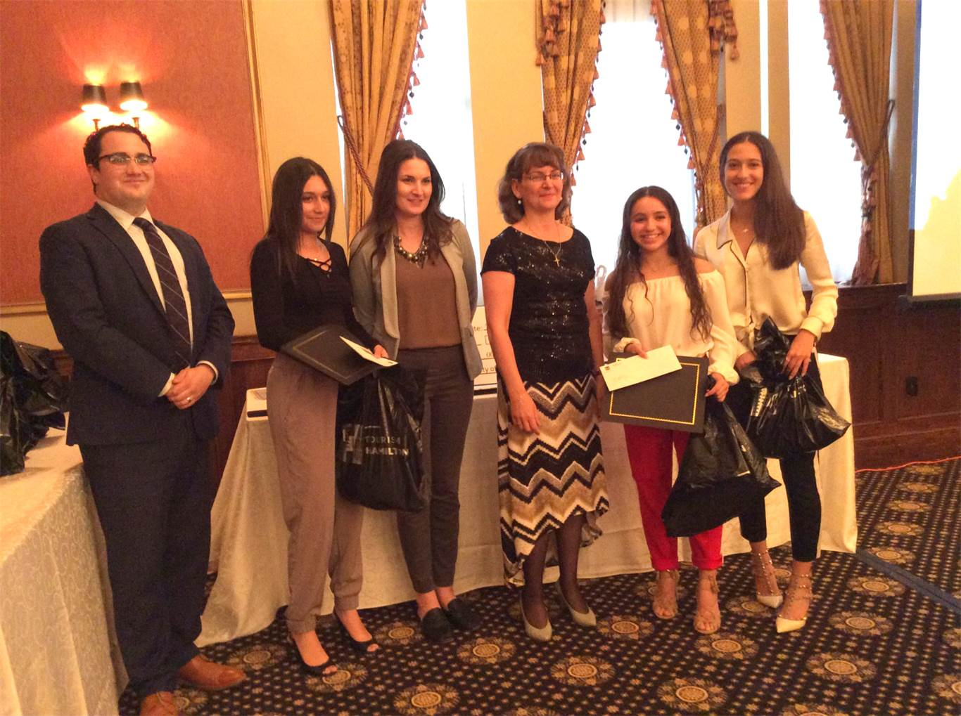 Pictured left to right:  Paul Demarco (from SimpsonWigle LAW LLP and judge for the competition), Isabella Carafano (student), Natalie Reid (from Mohawk College and judge for the competition), Mary Monaco (Sponsor of the Program), Ariana Commisso and Sofia Sergio (students).