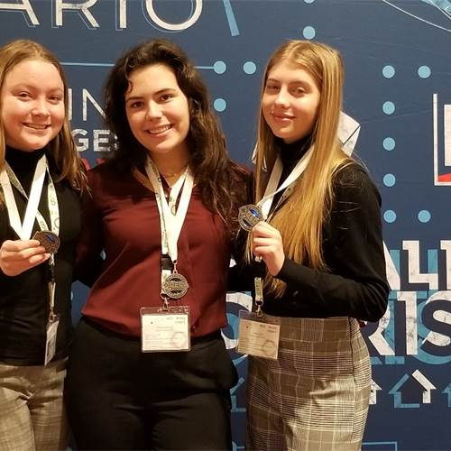 Pictured left to right: Stefanie Tsangarakis, Bianca Carnicelli and Sadie Lynch, grade 10 students who competed in a written event and presented their marketing compaign in the Integrated Marketing Campaign event on a Service. This team received medals for being in the top 15 overall of their event.